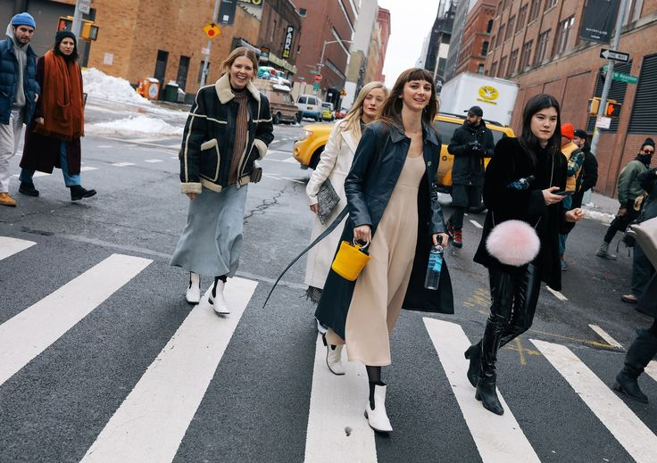 Megan Bowman Gray, Kate Foley, Brie Welch with a Simon Miller bag, and Anna Gray in Alyx pants and DVF bag