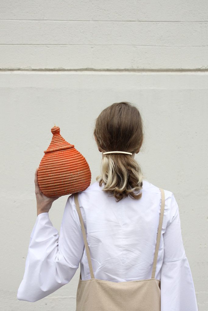 Mini Traditional Basket in Orange crafted by artisan weavers in Senegal. One of a kind, durable and high quality handwoven baskets. Perfect for storing away small household items completely out of sig