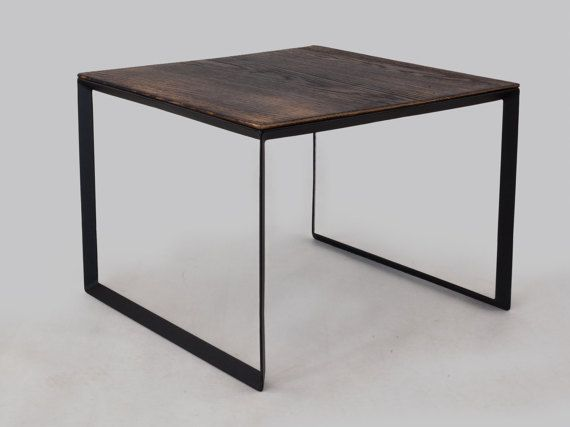 Table with original shape of the base, consisting of a flat bars at an angle of 45 degrees and oak wood top. In the presented model we combined steel black structure with brushed and burned oak top.   dimensions: 60cm x 60cm x 45cm  Top is 2 cm thick brushed and burned oak wood.