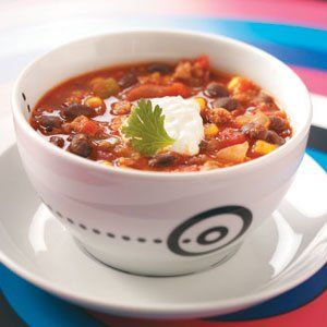 Family-Pleasing Turkey Chili Recipe -My children really love this turkey chili, and it's become one of their favorite comfort foods. It's relatively inexpensive, and leftovers are wonderful! —Sheila Christensen, San Marcos, California