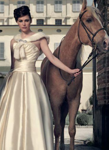 From our editorial - Sense and sensibility. Carlo Pignatelli gown, Dellera mink collar, Sharra Pagano brooch. #CarloPignatelli #gown #Dellera #collar #SharraPagano #brooch #bride #wedding