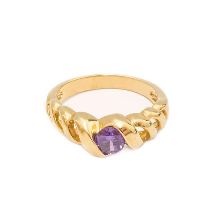 February purple gemstone ring with yellow twist band.