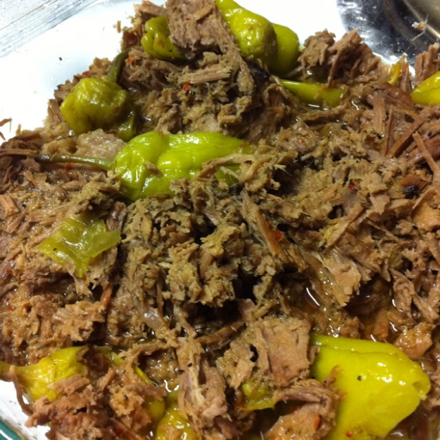 Italian beef - rump roast cooked in crock pot with jar of  pepperocini peppers dumped on top (including juice) and 2 pkgs Good Seasons Zesty Italian salad dressing mix sprinkled over all. Cook on low 8 hrs. Shred beef and serve on split hogie style roll with mozzarella cheese.  Yummy and warm and tangy!!