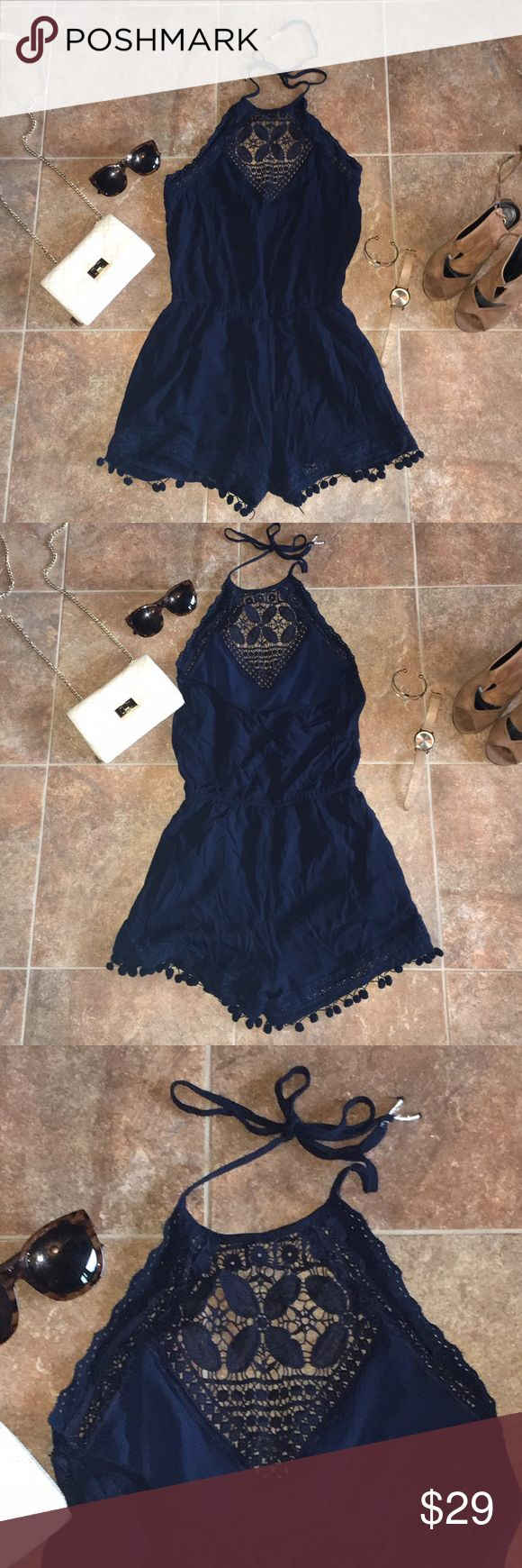 American Eagle Halter Romper American Eagle navy blue Halter top Romper with lace top and ball frills on bottom. Thick, quality material with extra layer underneath the bottom half. Excellent used condition!! Only worn a couple times. Size Small. American Eagle Outfitters Dresses Backless