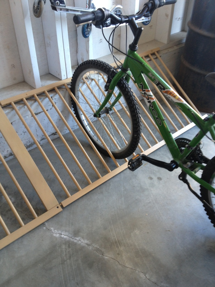 Make a bike rack out of a old baby crib!