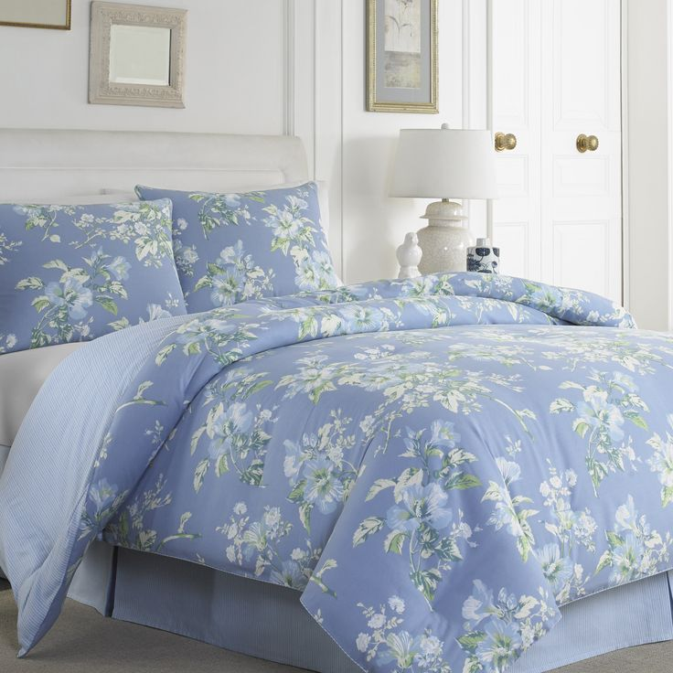 Add style to your home with this elegant comforter set by Laura Ashley. A floral print on a blue background features prominently in this lovely comforter set.