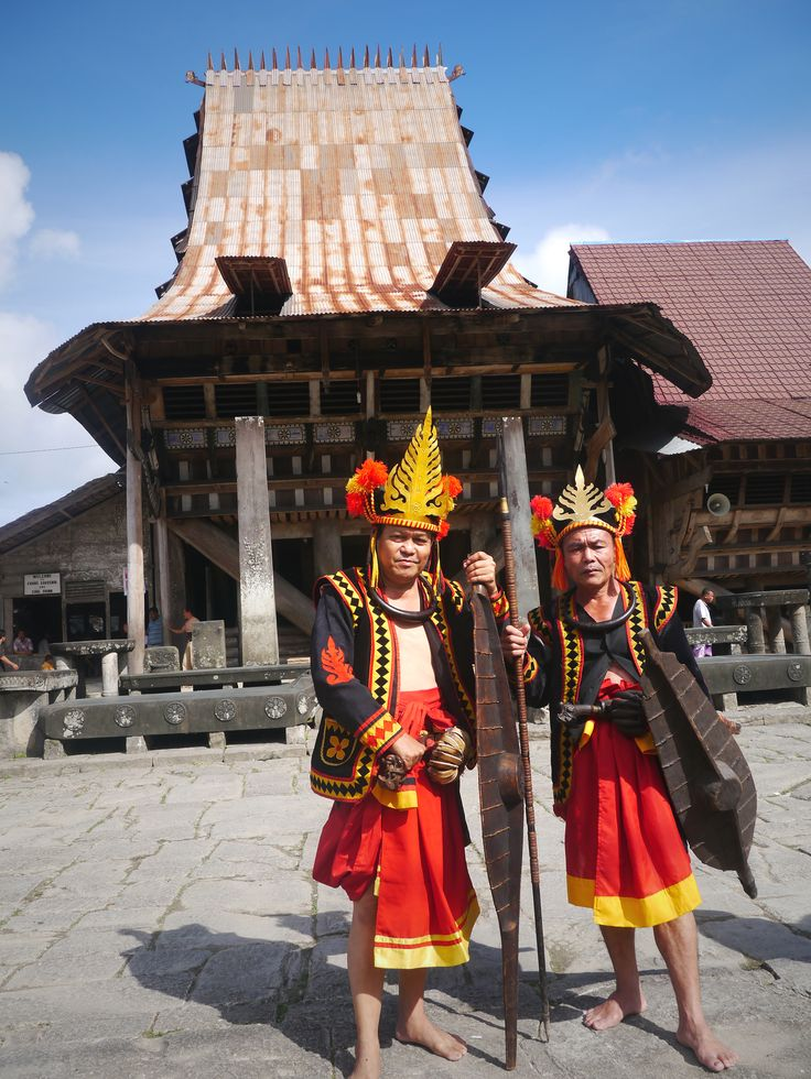 Nias people in front of Omo Sebua (king traditional House) photo by : fani atmanti