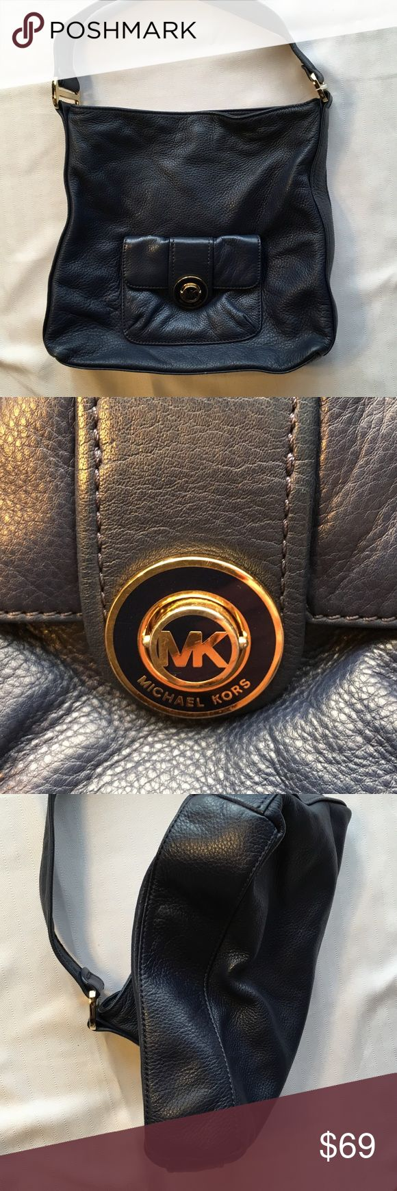 """Authentic Michael Kors Navy Handbag Excellent condition Michael by Michael Kors navy shoulder bag.  Approximate dimensions 12 1/2x13 1/2 x 2"""".  One very small scrape near the top of the front pocket see last pic.  Clean interior.  Smoke free, pet free home. MICHAEL Michael Kors Bags Shoulder Bags"""