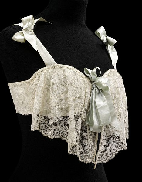 1905 Bust bodice - Victoria and Albert Museum. Satin and Machine Lace with pale grey ribbon. Early version of a bra.