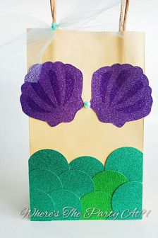 Send your guests off with this cute favor bag! Perfect for a Under The Sea or Mermaid themed party! Approximately 5 inches in width and 8 inches long. Accented with premium glittered cardstock and tulle tie. Custom orders are welcome in different themes, message for inquiries.The cost is per bag. Since these bags are made to order, please allow 5 business days for processing (creating) for every 25 bags before they can be shipped.