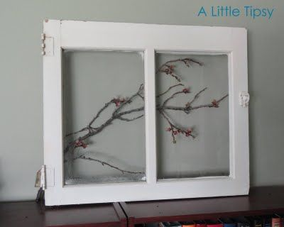 beautiful and springy - there's so much you can do with an old window #repurpose #diy