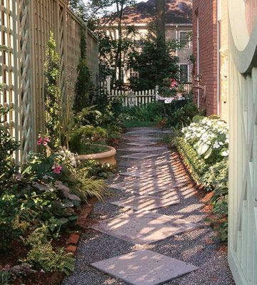 Narrow Walkway by bhg.com  Narrow spaces are popular places to add designed walkways. Here, two sizes of square precast concrete stepping-stones are set on the diagonal to form the base of a corridor through a side yard. Brick edging holds the gravel surrounding the squares in place.