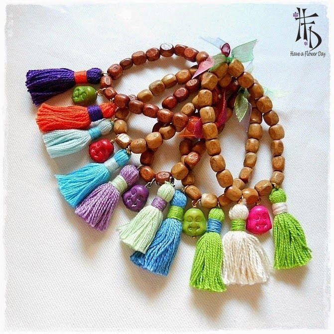 MALA BUDA. Collares y pulseras con cuentas de madera, borlas y budas / Necklaces and bracelets with wooden beads, tassels and Buddhas