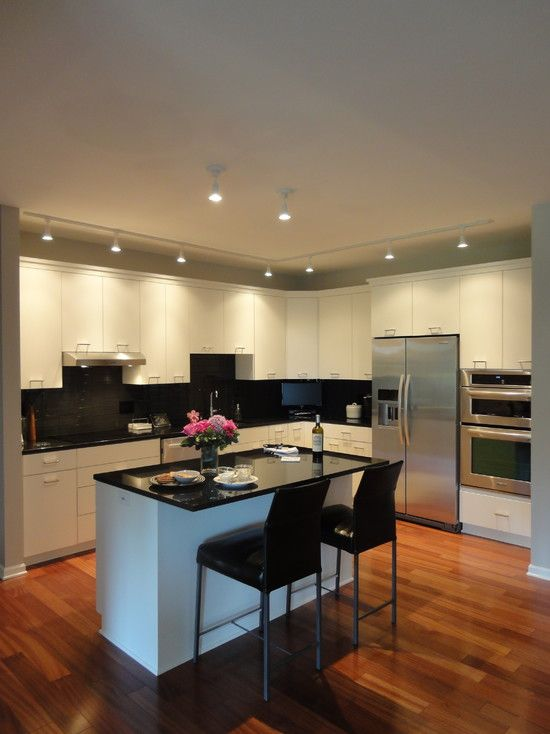 Condo kitchen black bar stools and contemporary kitchen for Modern kitchen design for condo