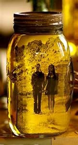 Mason jar filled with olive oil and a picture of your choice..great idea