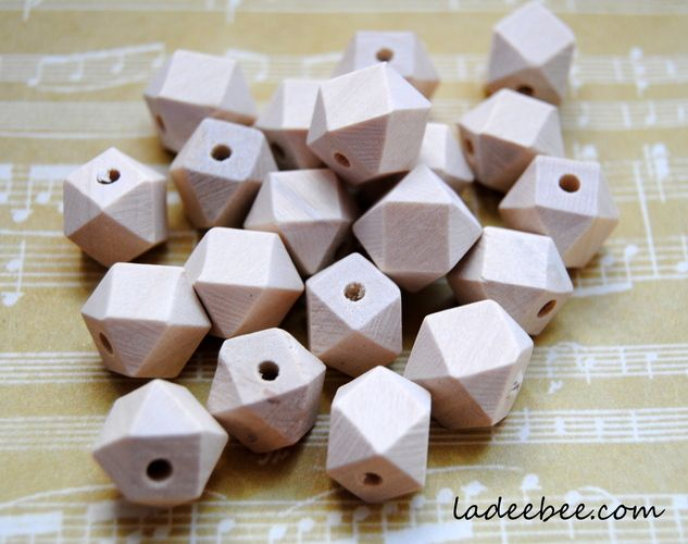 'Geometric Unfinished Wooden Beads' is going up for auction at 11am Tue, Aug 20 with a starting bid of $5.