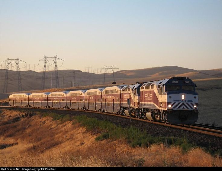 RailPictures.Net Photo: An ACE train passes climbs Altamont Pass at sunrise. Tracy, California by Paul Carr