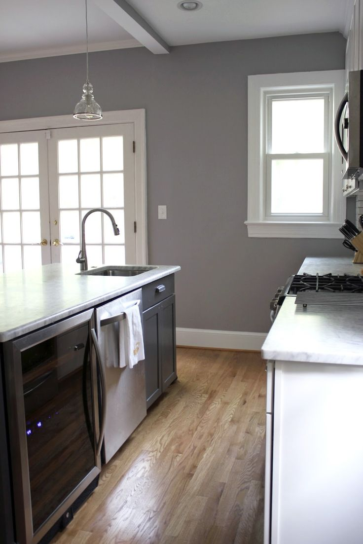 Behr porpoise i love the gray walls with the wood floors for Kitchen paint colors grey
