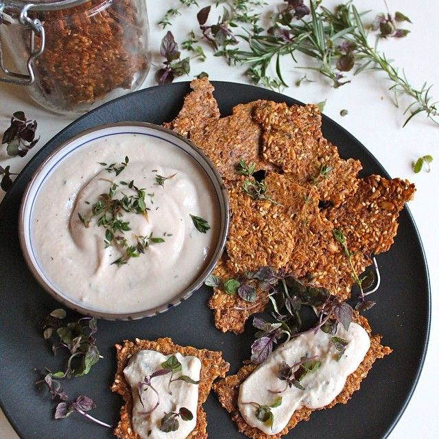 Gluten free grain and seed crackers with lemon, thyme white bean dip