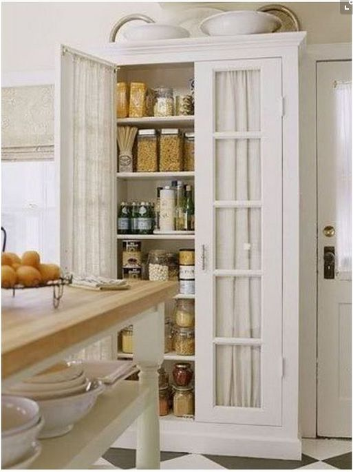 freestanding kitchen cabinets, kitchen storage ideas, furniture in the kitchen, hutch, pantry ideas, glass doors with linen fabric backdrop,