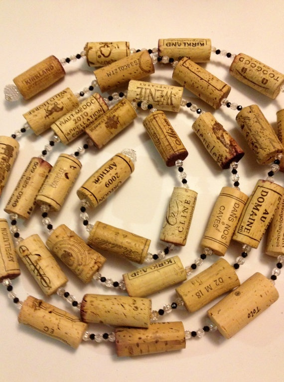 Wine Cork Garland 8ft.  22corks. 12 beads between each cork. drill corks down the center with a dremel. the new plastic/foam corks work better and don't crumble like real corks