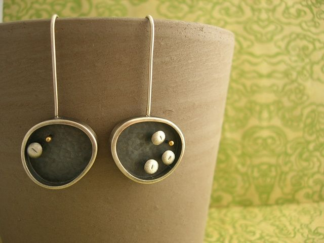 I have a necklace similar to this that I adore.  Silver Earrings, Janice Ho