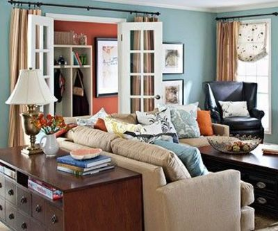 Room Inspiration | Love the open french doors with curtains behind them. Also love the behind-the-couch furniture.
