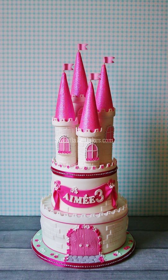 Talia loves this cute castle cake (but the colours would need to be light pink, hot pink, apple/lime green and white)