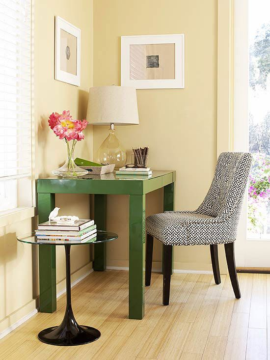 Even a small bedroom can boast a dual function. Here, a slim Parsons desk takes up minimal space and adds an office area. The bright green color makes a strong statement and a patterned chair adds more visual interest while e