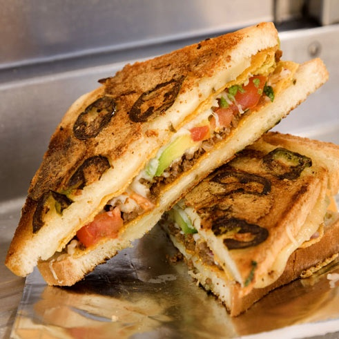 This Taco Melt Grilled Cheese is how tacos were meant to be eaten! #Recipe #GrilledCheese