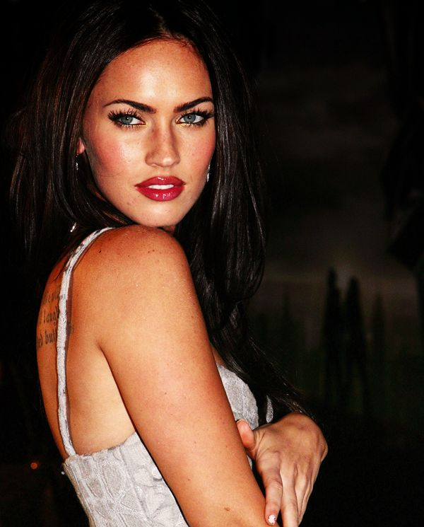 Megan Fox~ i honestly think she looked better before all the plastic surgery. ps her freckles are so pretttyyy!!