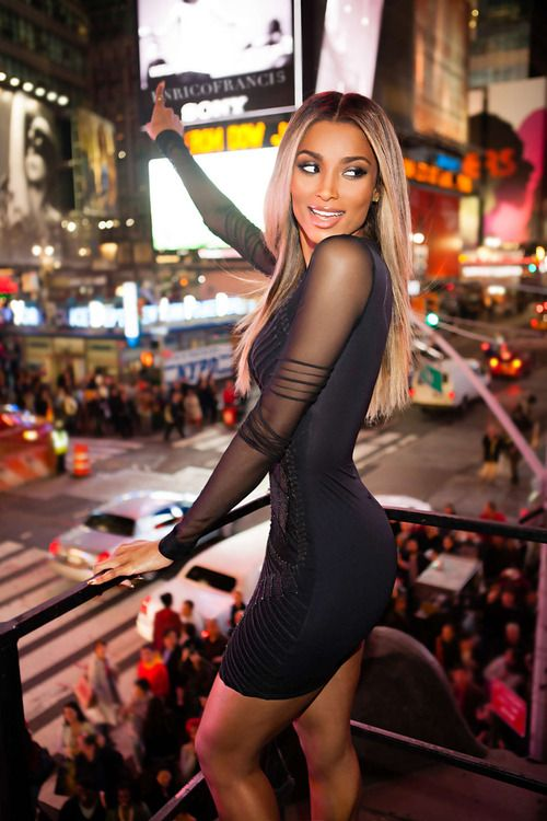 Ciara serving it up! Dark blonde roots like Nicki Minaj but darker low lights and more of a medium champagne blonde hair color throughout her hair. This is probably a lace closure with a sew in or a full lace wig.    http://www.howtoblackhair.com