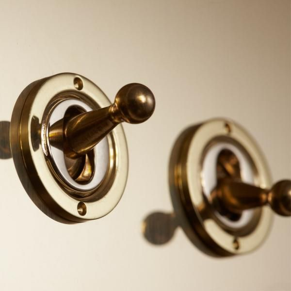 Unlacquered Brass Toggle Switches  Similar switch to the original ones in our house.