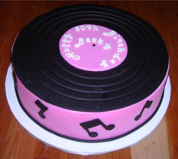 50's Record Cake - Fondant Record with fondant music notes and chocolate lettering.