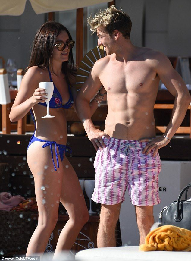 Young, free and very much single... for the summer: With temperatures soaring in Ibiza on Thursday afternoon, Made In Chelsea star Sam Thompson let his hair down with sultry co-star Emily Blackwell during a welcome break from the long-running, London based show