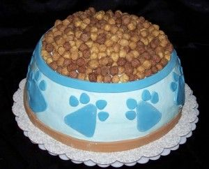 Adorable dog bowl cake! The kibble is made from Reese's puff cereal. Neat! *use melting chips and chocolate chips for paw prints on the side