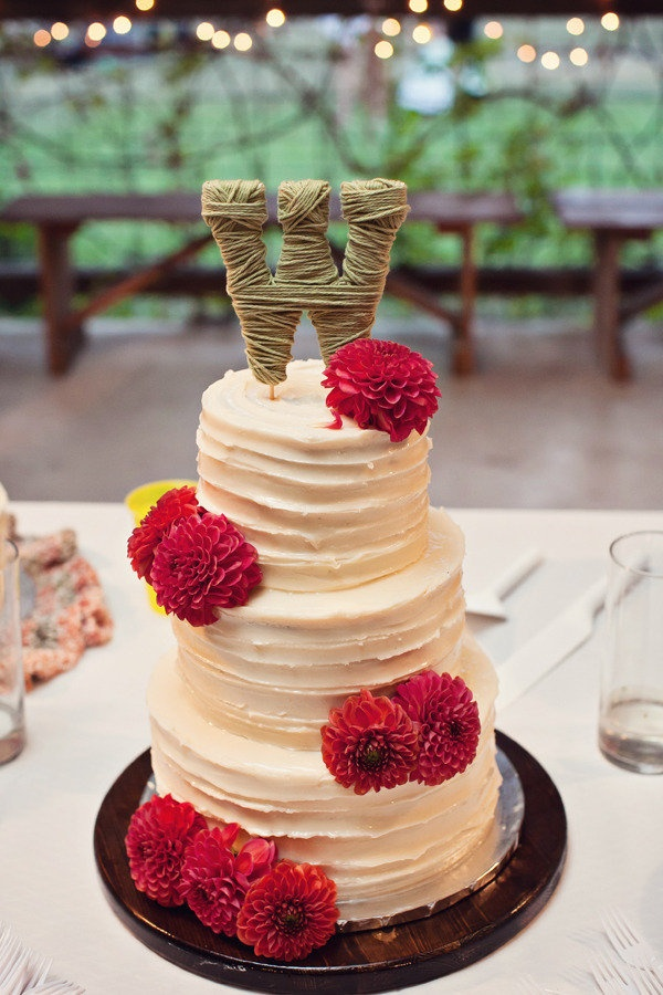 I like the look of the cake, orange flowers :) different topper