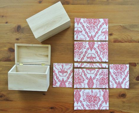 Decorate a plain wood box with tacky fabric and mod podge, then embellish away!