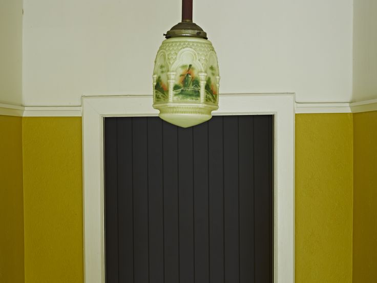 vintage pendant contrasting colour walls