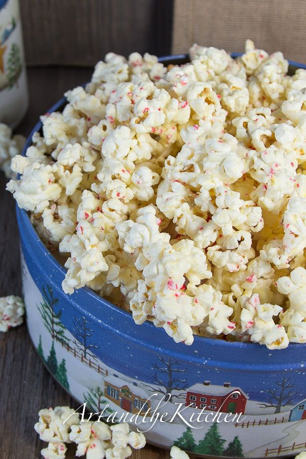 White Chocolate Candy Cane Popcorn - Art and the Kitchen,this addictive popcorn is so quick and easy to make with only 3 ingredients! Perfect to package in decorative tins or bags for a great hostess gift.