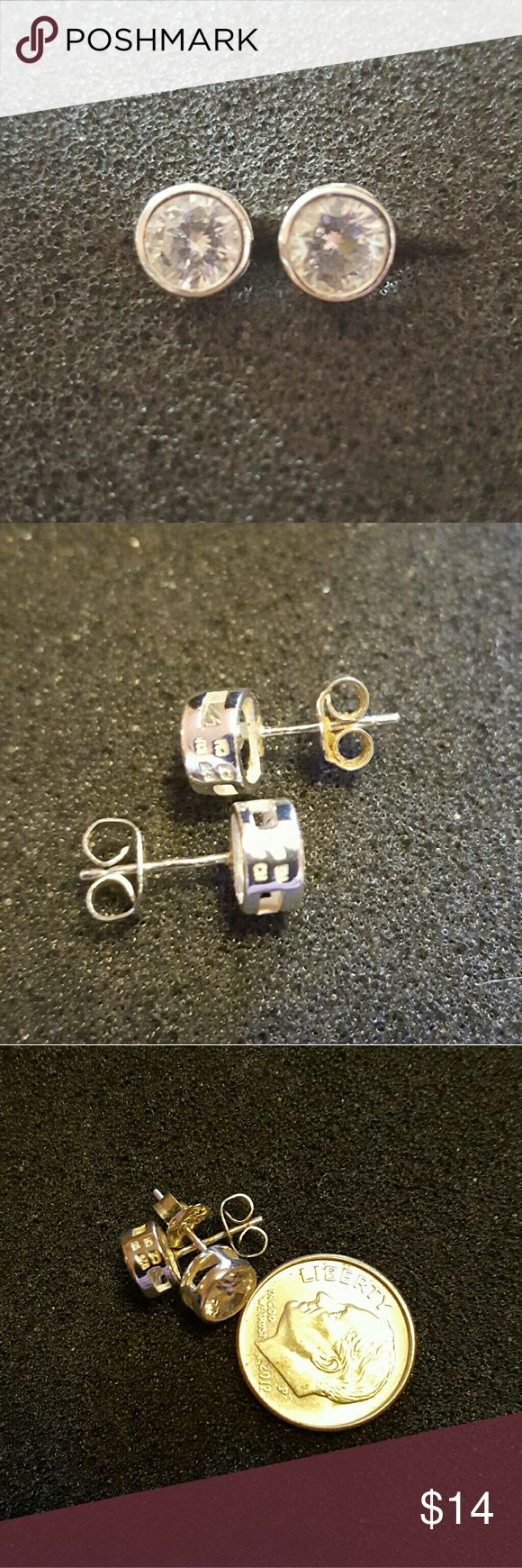 """Signed Sterling Silver Bezel Set CZ Earrings For your consideration is a pair of signed (side of mountings) 925 SU CZ CH sterling silver bezel set brilliant cubic zirconia pierced post earrings. Cubic zirconia measures approximately 3/16"""" in diameter. *One of the backs is not the original* Thank you. Vintage  Jewelry Earrings"""