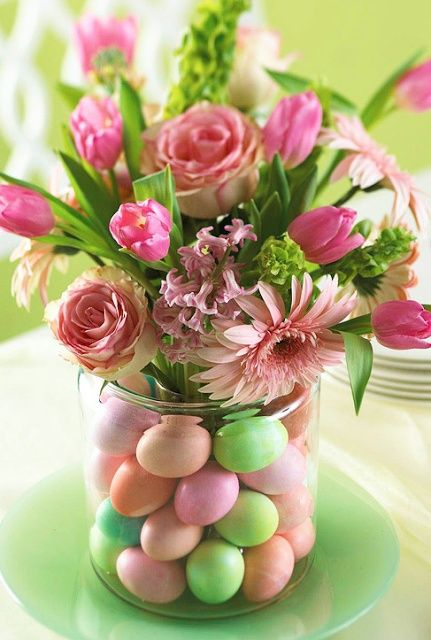 Easter centerpiece with flowers and eggs...simple but lovely!