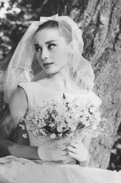 Audrey Hepburn vintage wedding style / gloves / pretty understated flower bouquet / veil with bow