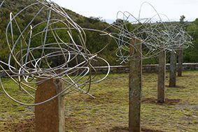 Drawing clouds. Sculpture made from standing stones and stainless steel wire.