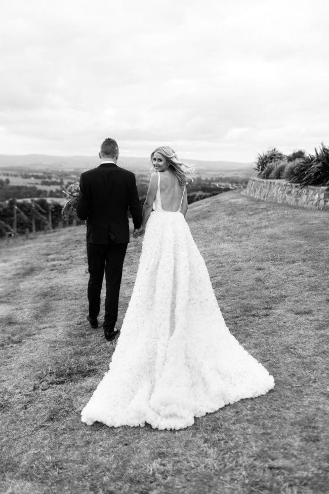 Wellness blogger Anna Weatherlake married Australian cricketer Peter Siddle in an elegant homestead wedding set in the Yarra Valley, Victoria. Venue: Levantine Hill Homestead Dress: All three, One Day Bridal Groom's suit: Sam & Ko Groom's Shoes: Brave Gentleman Rings: Anton Jewellery Hair: Mikal Dunn Make-up: Maggie Tamarua Fragrance: Mad et Len Dogs' attire: Bow ties from Etsy, custom collars by The Style Co. Shoes: Asos and Simmi Cake and dessert: Burch & Pur...