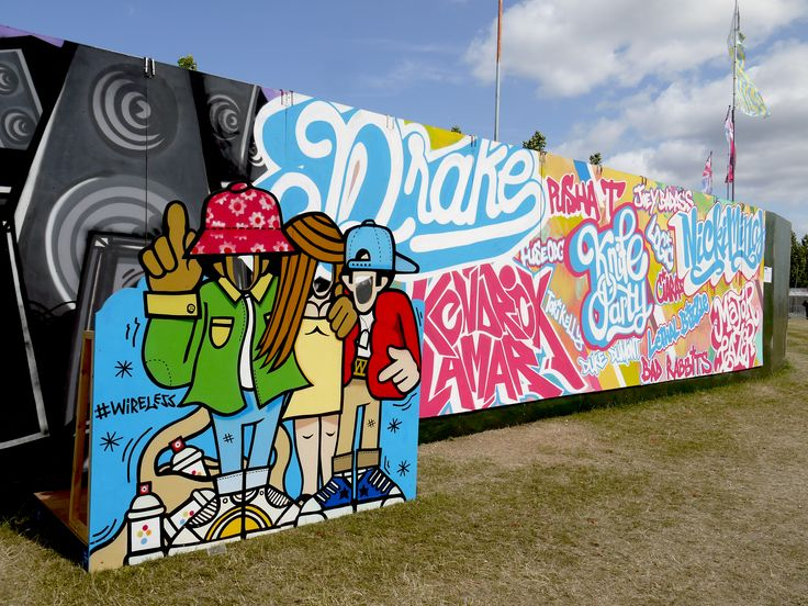 Wireless Festival 2015 - Photos were aplenty as people engaged with this and the two-urban free-standing sally boards either side of the mural – sticking their heads through the holes and posing appropriately. #liveart #brandactivation#event #mural #graffiti