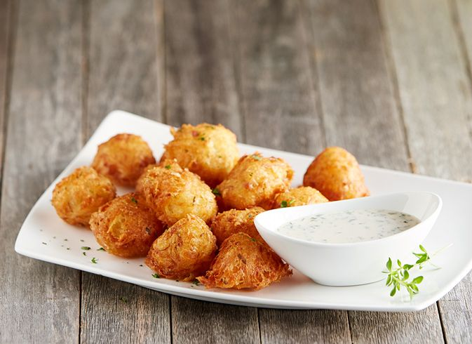SAVORY POTATO TOTS: Light and crispy dauphine potatoes with prosciutto, shallots and herbs.