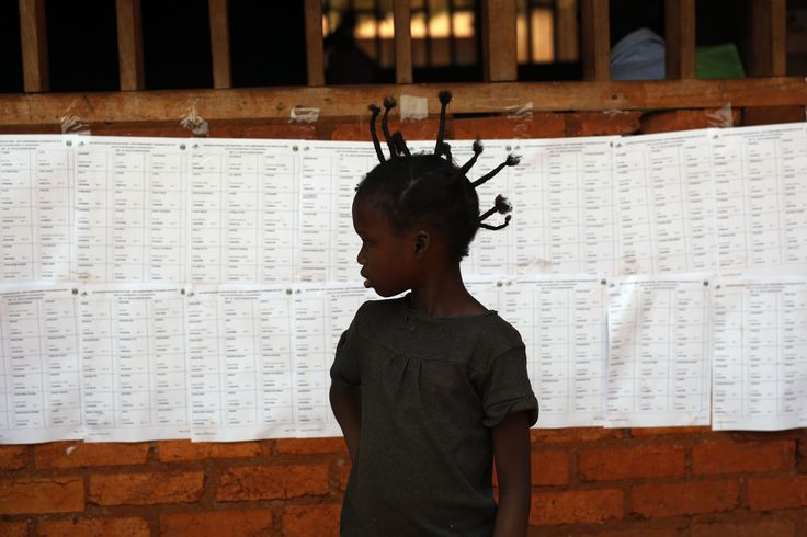 A child stands in front of a voters' list at a polling station in Bangui, Central African Republic on February 14, 2016. (Jerome Delay/AP)