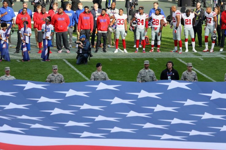 Giants vs. Rams in London:     October 23, 2016  -   17-10, Giants  -  Players line up for the national anthems before an NFL game between the New York Giants and the Los Angeles Rams at Twickenham Stadium in London, Sunday Oct. 23, 2016.