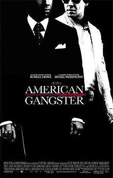 A black and white picture, depicting Frank Lucas in a black suit and Richie Roberts in a white one. In front of them is the title American Gangster, with Russell Crowe and Denzel Washington's names above, and the film credits below.